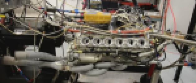 Watch a vintage Ferrari racing engine shoot blue flames on a dyno